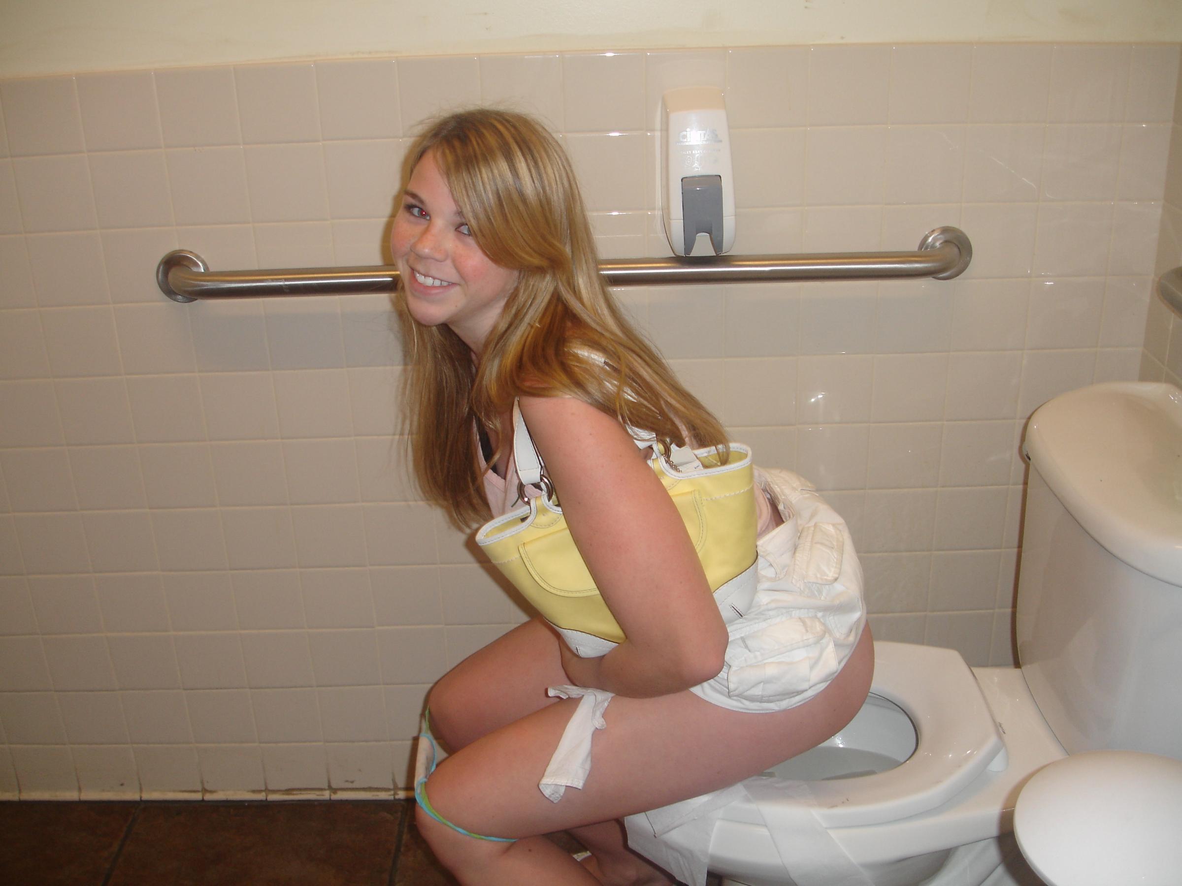 Girls in toilette pissing teen